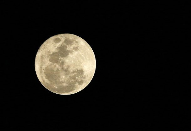 epa04547292 A full moon reclects the sunlight as seen from Manila, Philippines, 05 January 2015. The first Full Moon in January is also known as the 'Full Wolf Moon', a name coming from native Americans who connected it to the howling of the hungry wolves outside their villages. EPA/DENNIS M. SABANGAN